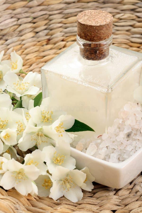 Jasmin bath. Beauty treatment - jasmin flowers and cosmetics royalty free stock photography