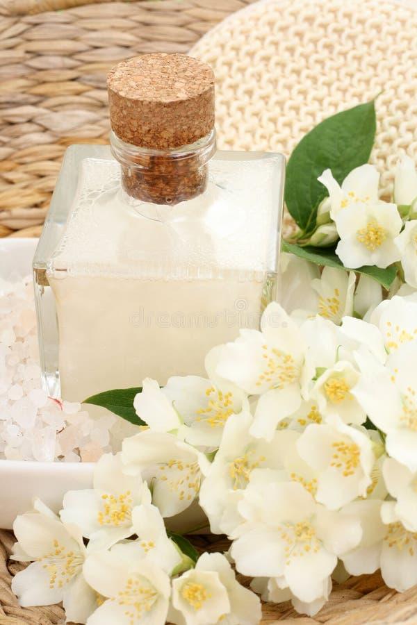 Jasmin bath. Beauty treatment - jasmin flowers and cosmetics stock image