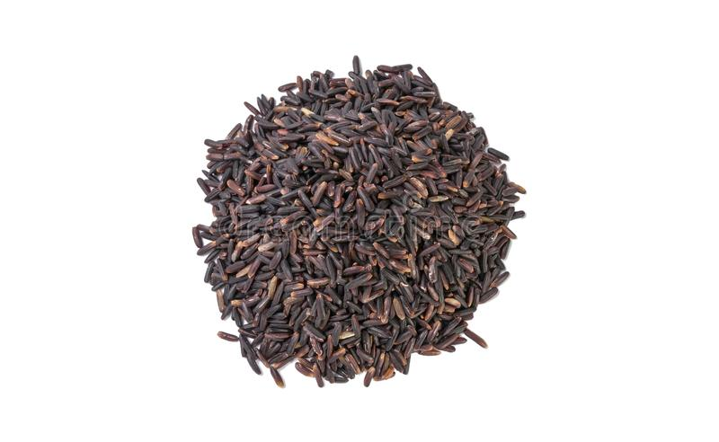 Jasmine black rice heap isolated on white background. nutrition. bio. natural food ingredient. top view stock images