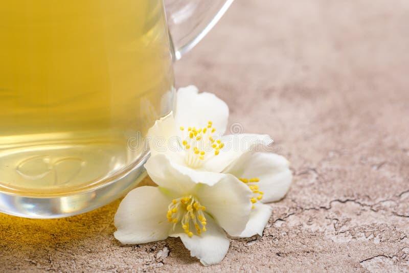 Jasmine flowers. Green tea with jasmine. Jasmine flowers. Green tea with jasmine in a glass container stock photos