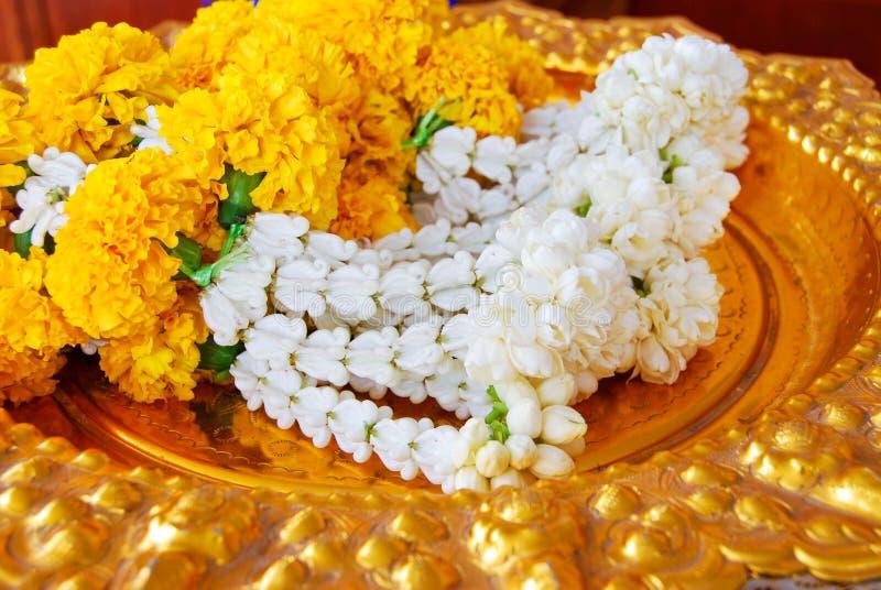 Jasmine garland on gold plate