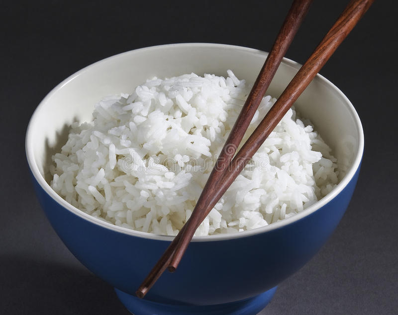 Jasmine rice in the rice bowl isolated royalty free stock photos