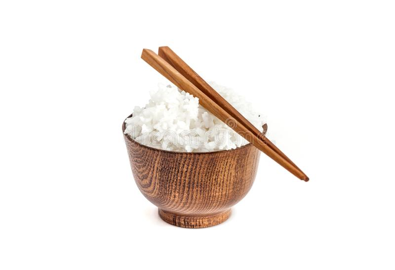 Jasmine rice hot cooked in wooden bowl with chopsticks. Isolated on white background ready to eat, rice cooked is a eating culture of asian people royalty free stock photo