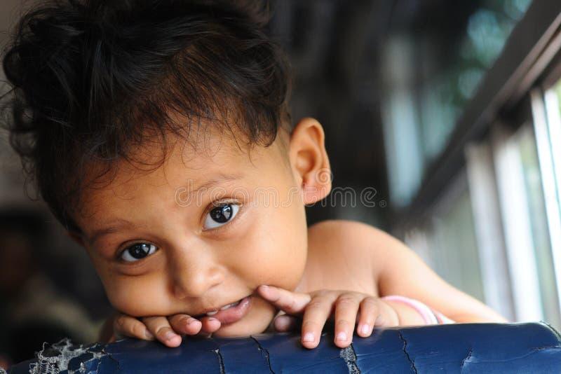 Jasne oczy szczęśliwego dziecka zdjęcie stock