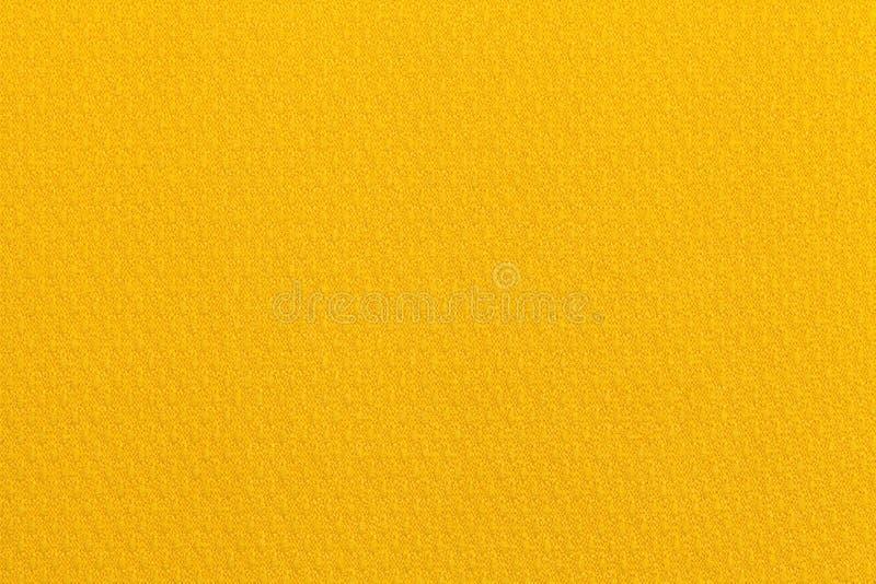 Jasnożółty ocher tło od tekstylnego materiału Tkanina z naturalną teksturą tło fotografia stock