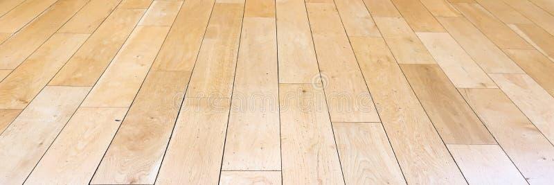 Jasnobrązowa miękka drewniana podłoga powierzchni tekstura jako tło, polakierowany drewniany parkietowy Stary grunge myjący dębow obrazy royalty free