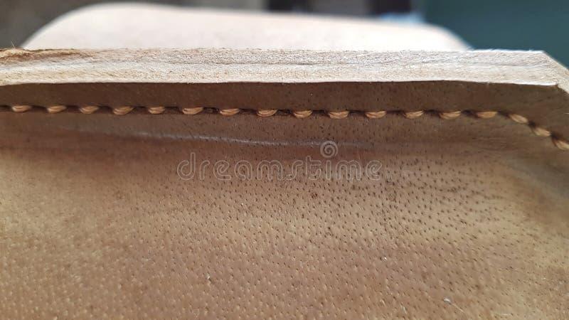 Jasnobrązowa skóra szy z lekkimi niciami zdjęcia stock