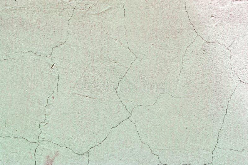 Jasnozielona ściana z pęknięciami Betonowy stary nakrycie tło niezwykły zdjęcia royalty free