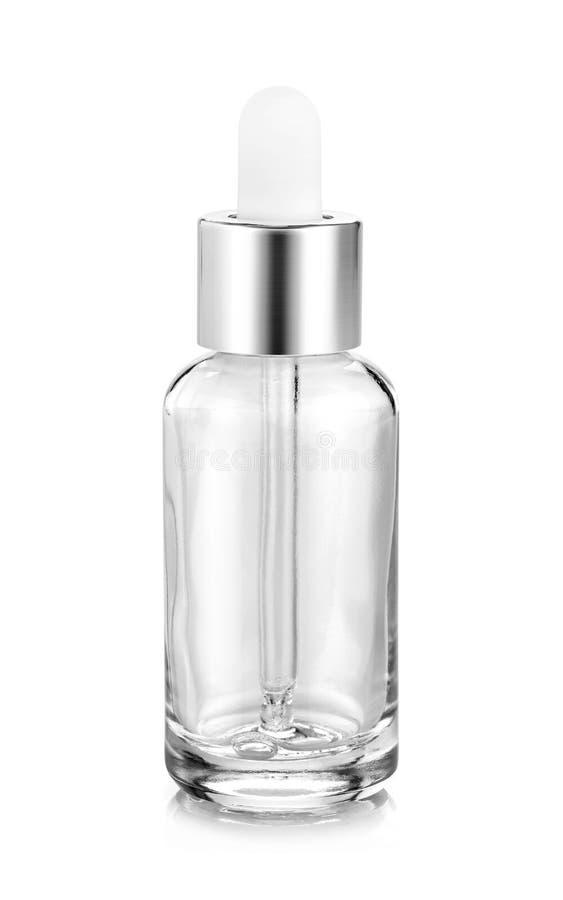 Jasny szklany serum botle dla kosmetycznego produktu projekta w górę obrazy stock