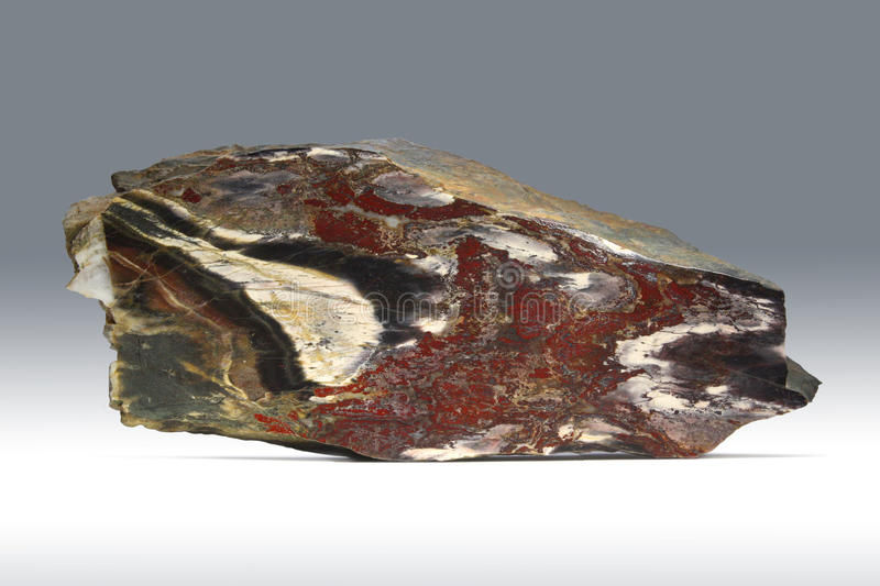 Jasper. Fine sample of motley colourful jasper for your mineralogical collection stock image