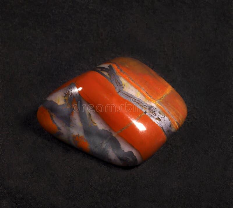 Jasper polished stone on black background royalty free stock images