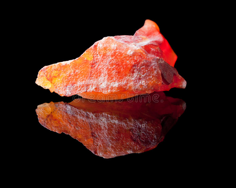 Jasper stone. Jasper is an ornamental rock composed mostly of chalcedony, microcrystalline quartz, together with other minerals, which give it colourful bands royalty free stock photography