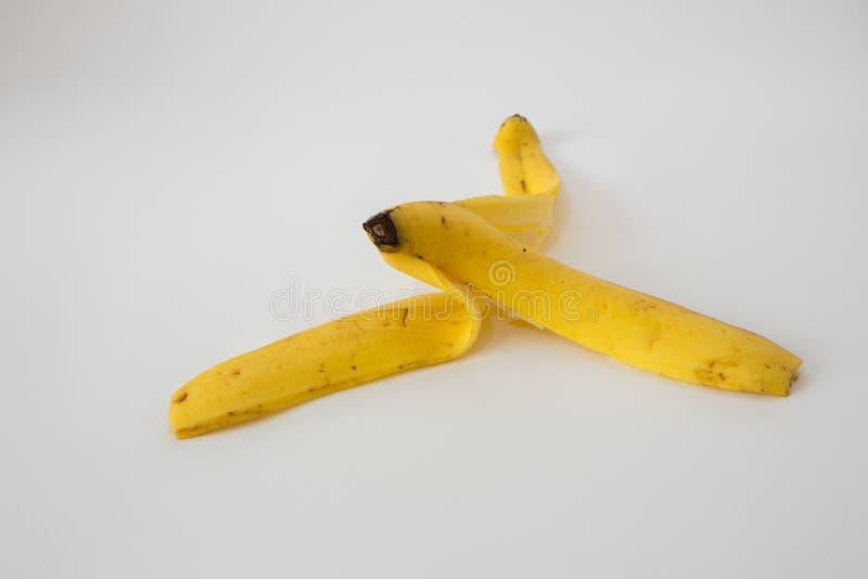 jaune blanc de peau d'isolement par fruit de banane de fond photos libres de droits