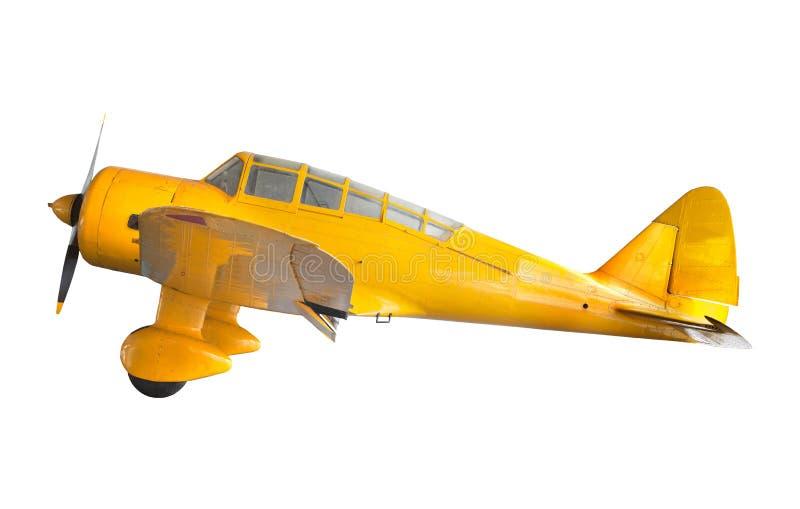 Jaune classique blanc d'isolement vieil par avion images stock