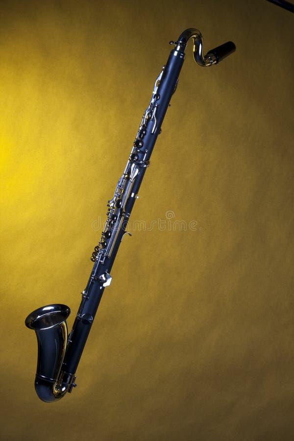 jaune d'isolement de clarinet bas photo stock
