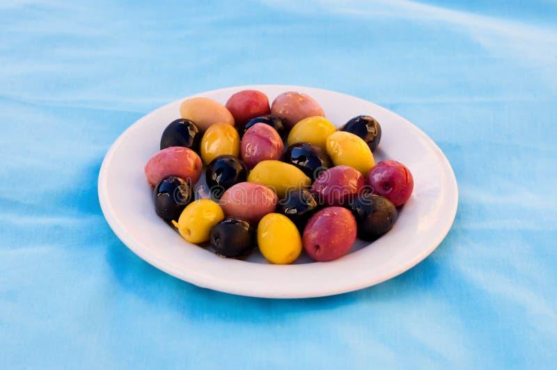 Jaune olive et rouge marocain et noir du plat blanc images stock