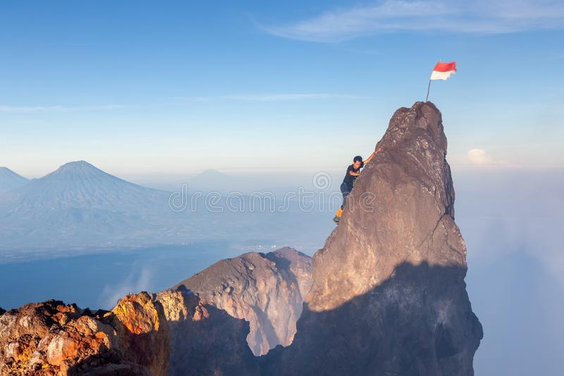 Java/Indonesia - Apr 8, 2015: Indonesian climber. Java/Indonesia - Apr 8, 2015: Indonesian climber climbing to highest peak of Merapi volcano at Java island stock images