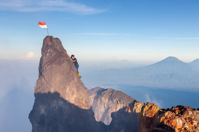 Java/Indonesia - Apr 8, 2015: Indonesian climber. Java/Indonesia - Apr 8, 2015: Indonesian climber climbing to highest peak of Merapi volcano at Java island stock photos