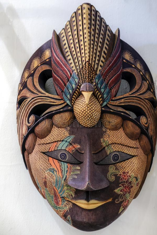Javanese Batik Mask made of wood on a white background stock photography