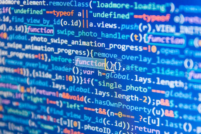 Javascript code in bracket software. Programmer typing new lines of HTML code. royalty free stock photos