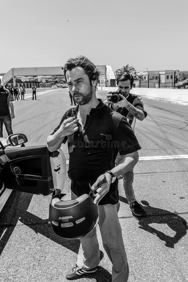 Jay Kay de Jamiroquai que conduz Aston Martin no autódromo de Kyalami fotos de stock