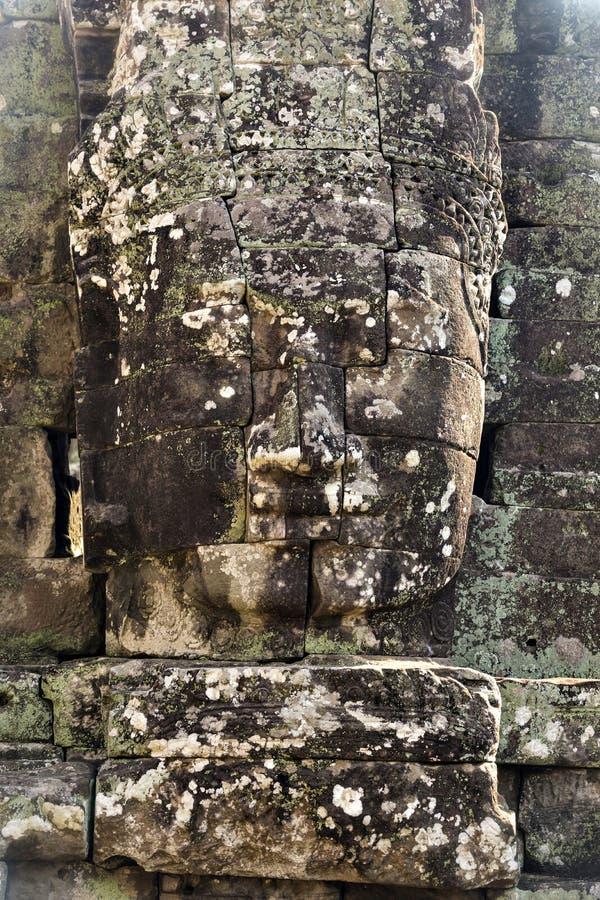 Jayavarman国王的古老石面孔VII在Bayon寺庙, 免版税图库摄影