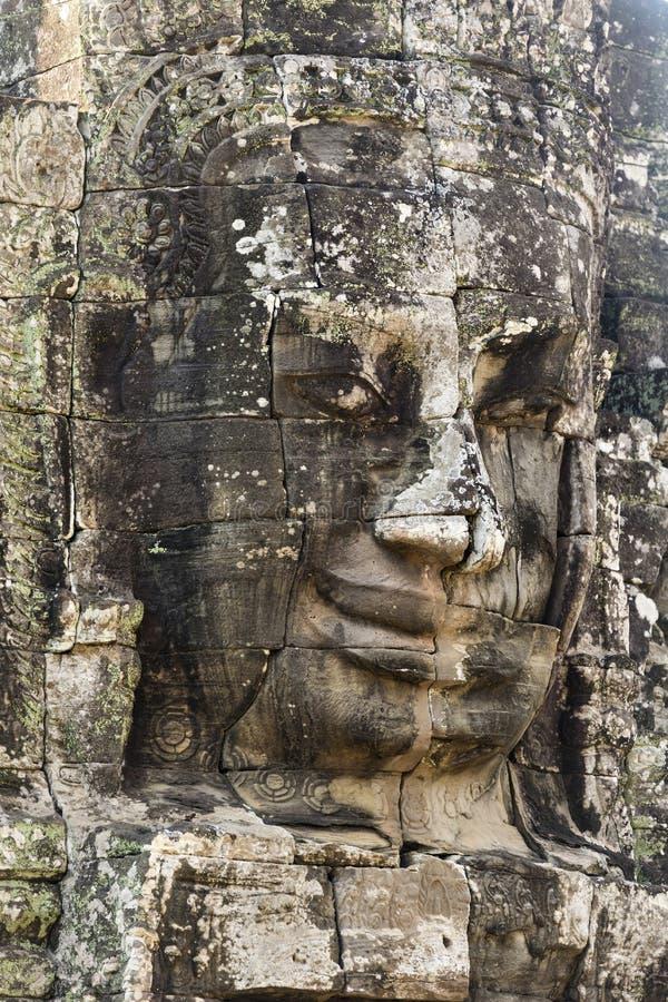 Jayavarman国王的古老石面孔VII在Bayon寺庙, 库存照片