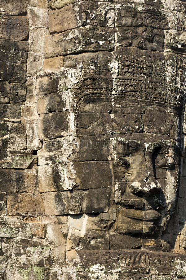 Jayavarman国王的古老石面孔VII在Bayon寺庙, 图库摄影
