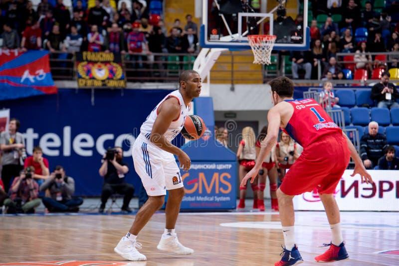 Jayson Granger (15) vs Nando De Colo (1). MOSCOW, RUSSIA - JANUARY 27, 2017: Jayson Granger (15) vs Nando De Colo (1) on before basketball game CSKA vs Anadolu stock photography