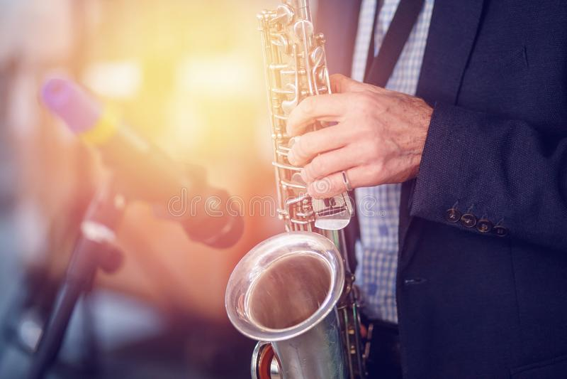 Jazz man musician playing saxophone with sun light royalty free stock photo