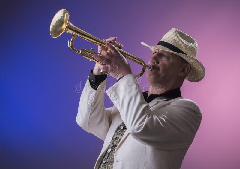 Jazz man playing the trumpet royalty free stock photos