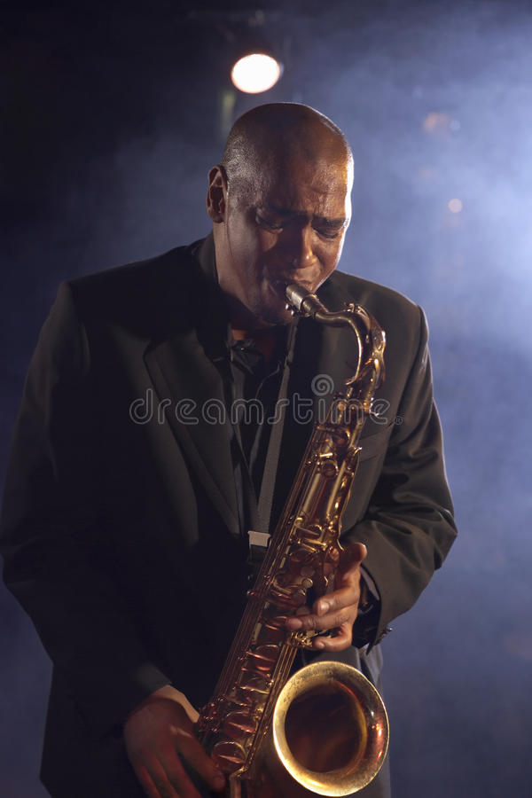 Jazz Musician With Saxophone stock foto's