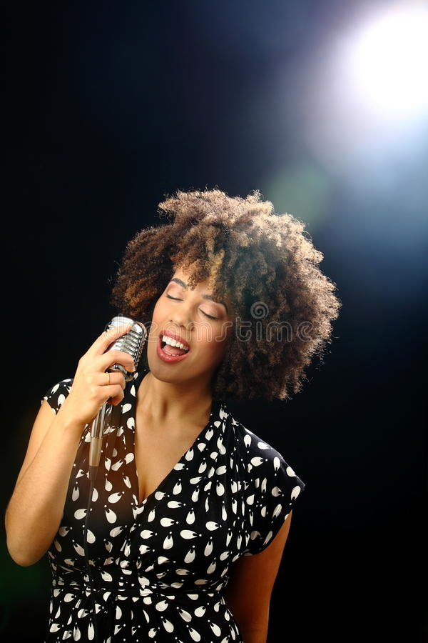 Jazz singer on stage stock photography