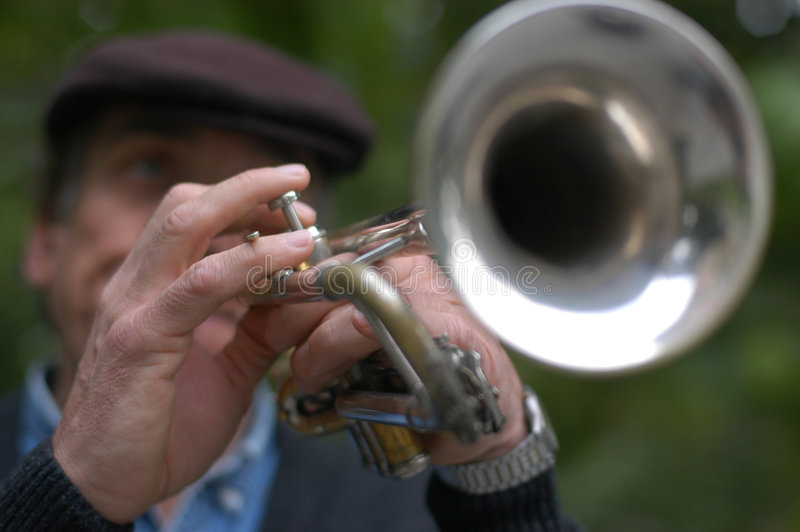 Jazz trumpetist. Trumpetist playing in a park royalty free stock photography