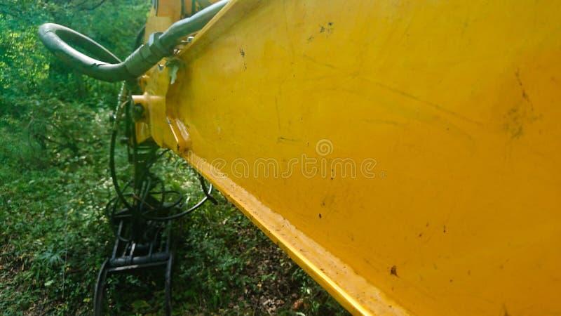 JCB Digger In Forest Deforestation imagenes de archivo
