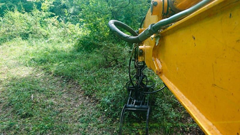 JCB Digger In Forest Deforestation imagen de archivo