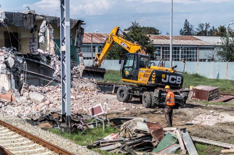 JCB excavator demolishes an old building.  stock photos