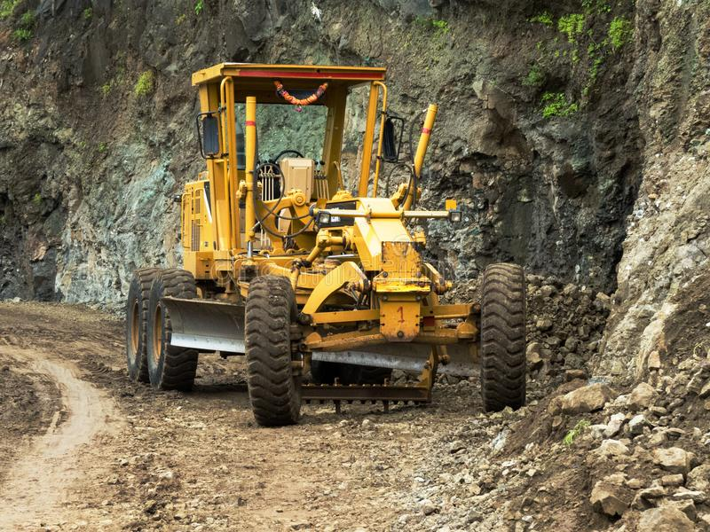 JCB Machine Excavators or Digger on Site. A Yellow JCB Machine Excavators or Digger on Under Construction Road Site on Ghaat of Some Mountain Near Indore, India stock image