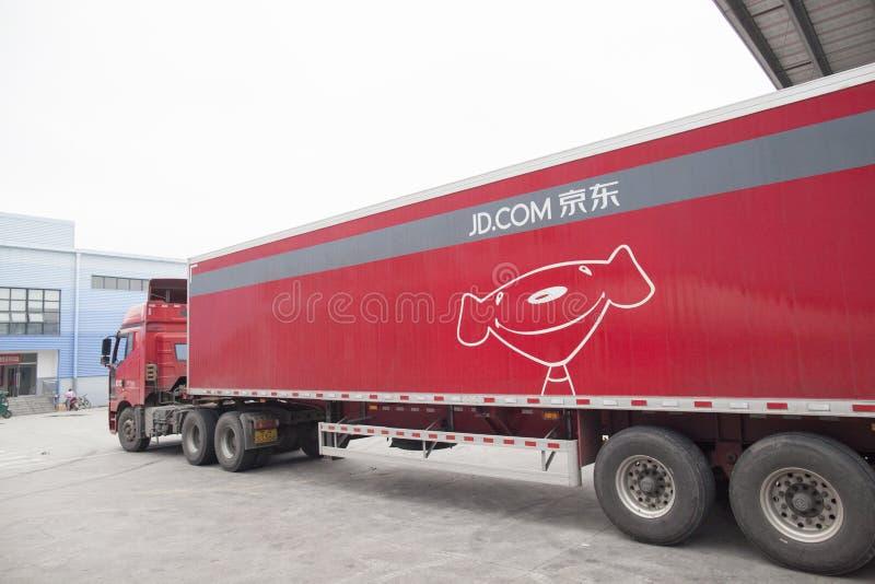 JD com-sändningslastbilar arkivbild