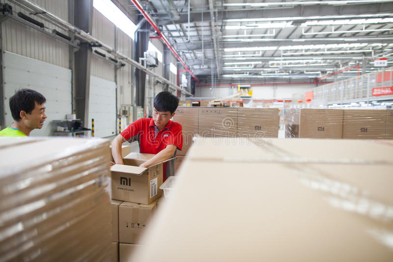 JD.com staff receiving incoming goods, sorting products, and preparing shipments at the Northeast China based Gu'an warehouse stock photography