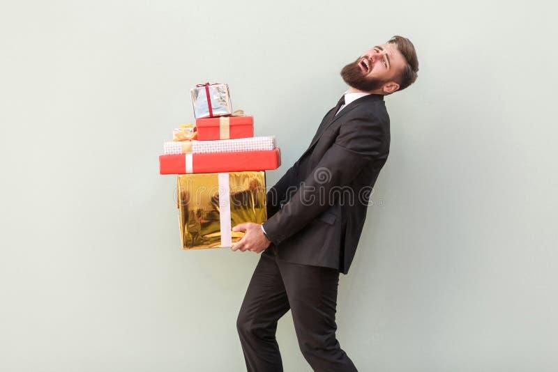 Je peux plus ne porter ces boîtes Cri d'homme d'affaires photos stock