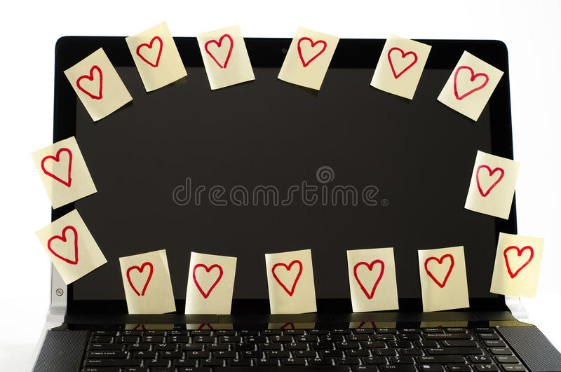 Je t'aime notes sur l'ordinateur photos stock