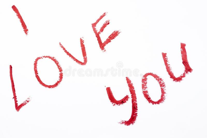 Je t'aime rouge à lèvres peint sur le fond blanc photos stock