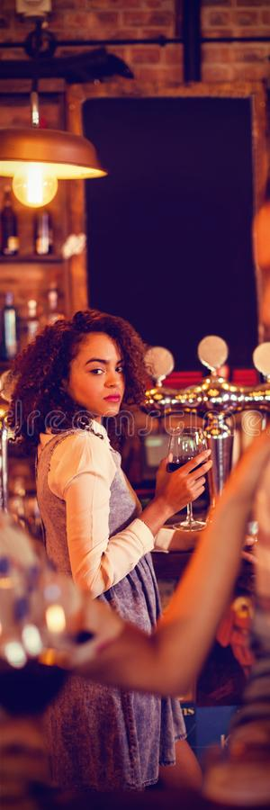Jealous woman looking at couple flirting with each other. Jealous women looking at couple flirting with each other in pub royalty free stock photo