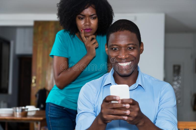 Jealousy african american woman distrust her boyfriend. Jealousy african american women distrust her boyfriend at home stock photos