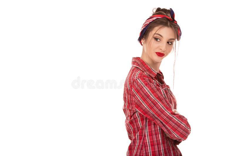 Jealous young woman arms crossed turned looking back envious stock photos
