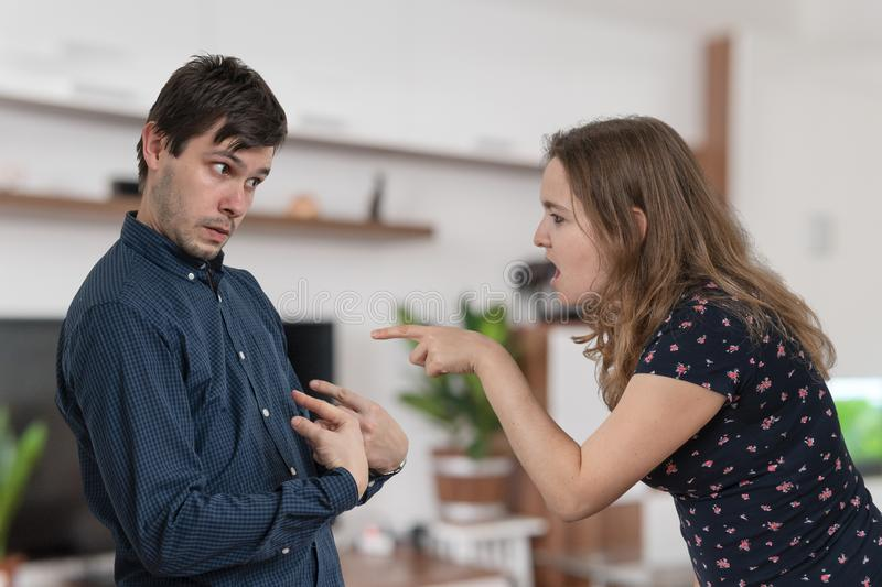 Jealousy hysterical woman is blaming and shouting on her husband. Jealousy hysterical women is blaming and shouting on her husband royalty free stock photo