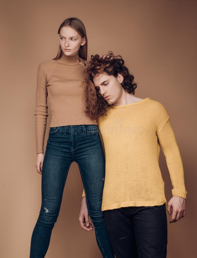 Jealousy of partners. Portrait of a good-looking male and female, standing twogether. self-confident young woman and stock photography