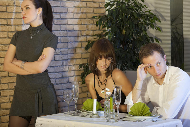 Jealousy scene in restaurant. Jealousy scene between couple in a restaurant royalty free stock images