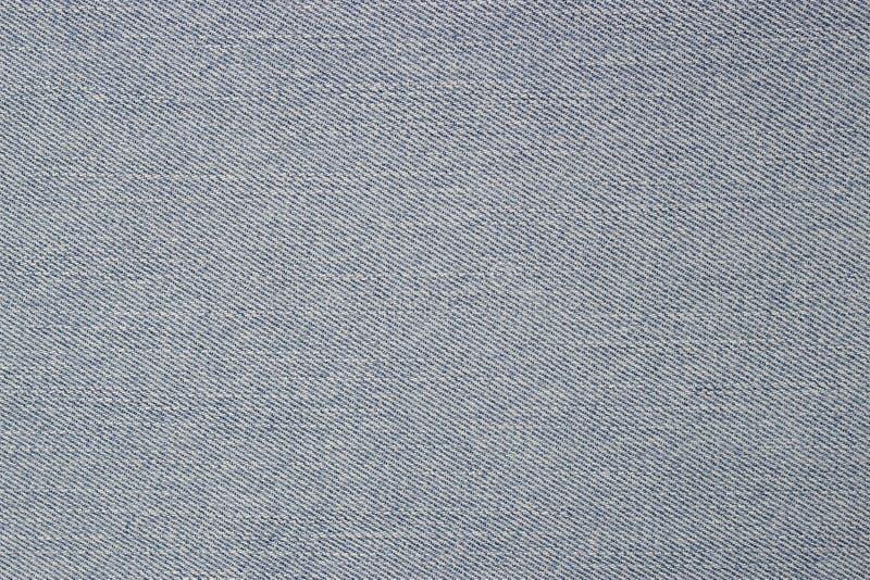 Jean azul descolorado imagenes de archivo